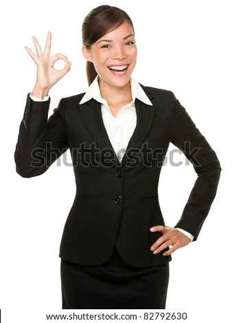Perfect - business woman showing OK hand sign smiling happy. Young pretty Asian / Caucasian businesswoman isolated on white background. - stock photo