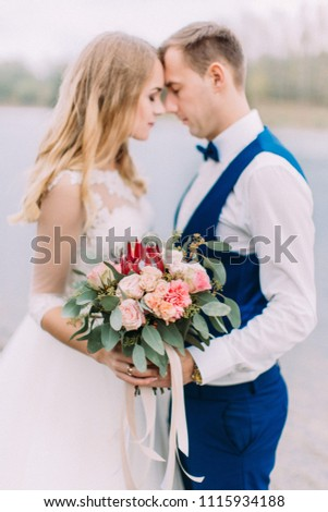 Perfect colourful wedding bouquet in the hands of the newlyweds. #1115934188