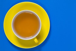 Perfect cup of tea on blue wooden table  - Flat lay image