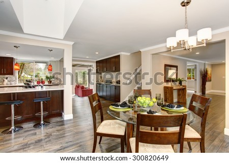 Perfect dinning room with glass table, and green apples as decor.