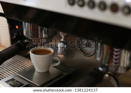 perfect espresso shot with the espresso machine in the espresso bar #1381224137