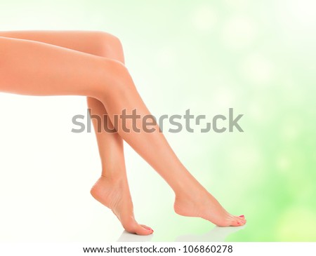 Perfect female legs on green blurred background