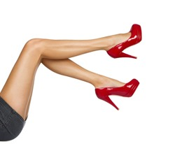 Perfect female legs wearing high heels isolated on white background