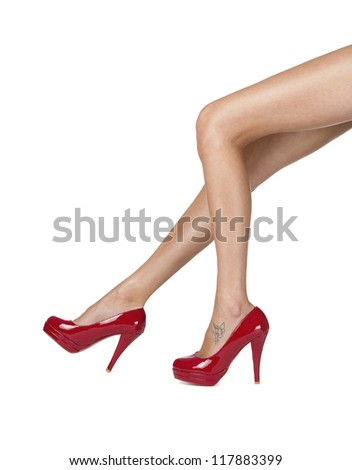 Perfect female legs with red high heels isolated on white background