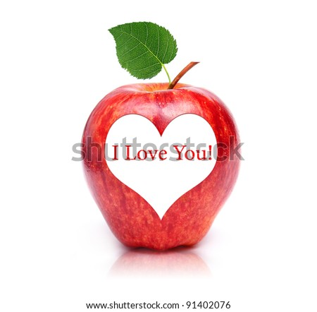 Perfect fresh red apple with a heart shaped in text area inside - stock photo
