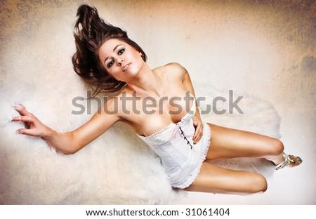 Perfect girl's body in white sexy corset