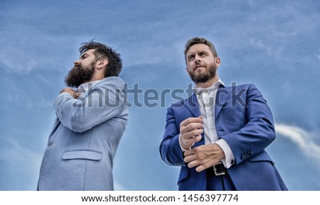 Perfect in every detail. Impeccable appearance improves reputation professional entrepreneur. Bearded entrepreneurs posing confidently bottom view. Business men stand back to back blue sky background.