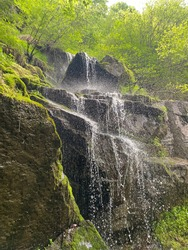 Perfect moment of a water dropping from a waterfall. Picture taken in Vitosha mountain in Sofia.