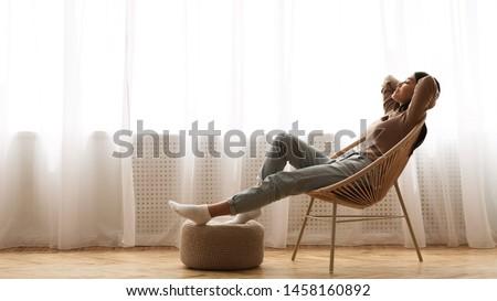 Perfect Morning. Girl Sitting in Armchair near Window, Enjoying Free Time
