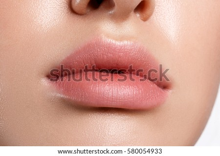 Perfect natural lip makeup. Close up macro photo with beautiful female mouth. Plump full lips. #580054933