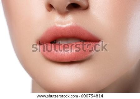 Perfect natural lip makeup. Close up macro photo with beautiful female mouth. Plump full lips. #600754814