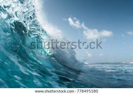 Perfect ocean wave breaking on the shore. Surfspot named Jailbreak, Maldives