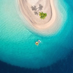 perfect palm island in the turquoise ocean, travel to the paradise