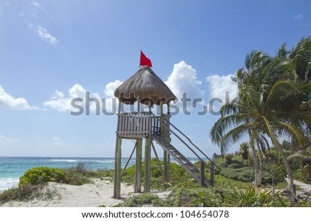 perfect paradise beach with a wooden lifeguards tower, mexican caribbean coast