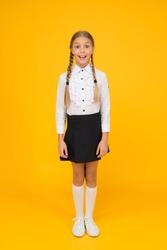 Perfect schoolgirl. Small schoolgirl with happy smile. Little schoolgirl looking nice in school uniform. Cute schoolgirl with long hair. Welcome back to school. Graduation concept. Primary education.