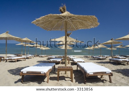 Perfect sea holiday view with sun umbrellas and chairs