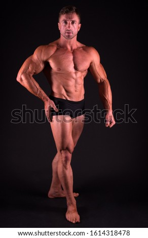Perfect shape. Bodybuilder concept. Bodybuilder man with strong body. Bodybuilder with six pack and ab muscle. Sexy bodybuilder with muscular torso. Bodybuilding sport. Power of muscles concept.
