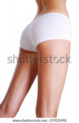 Perfect shape of woman's buttocks - studio shot on white