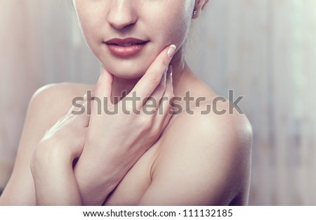 Perfect skin concept. Portrait of beautiful girl over light background