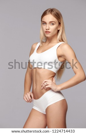 Perfect slim toned young body of the girl or fit woman at studio. The fitness, diet, sports, plastic surgery and aesthetic cosmetology concept. #1224714433