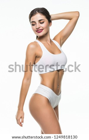 Perfect slim toned young body of the girl or fit woman at studio. The fitness, diet, sports, plastic surgery and aesthetic cosmetology concept. #1249818130