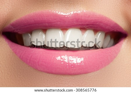 Perfect smile. Beautiful full pink lips and white teeth. Teeth whitening