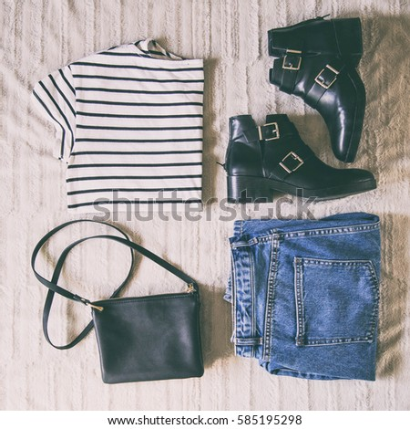 perfect spring outfit. flat lay of a trendy fashion outfit, sunglasses, denim jeans, striped shirt, black ankle boots and a small elegant black purse. top view. #585195298