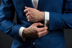 Perfect to last detail. Getting dressed. Formal suit shirt and cuffs. Wearing formal style. Fashion and style. Formal clothes. Dress code. Wedding ceremony. Holiday celebration. Formal and classy.