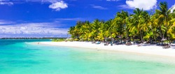 Perfect tropical white sandy beach Trou aux biches with turquoise sea. Mauritius island holidays