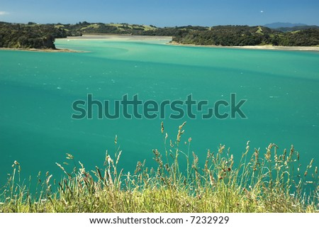 Perfect vacation image - Green sea, beach, blue sky, islands, bays,  sunshine. Like a paradise. Tourist attraction Mahurangi national park, New Zealand - stock photo