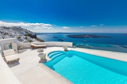 Perfect view in Santorini with white architecture luxury infinity pool over cruise ships and blue sea. Luxury summer vacation and holiday concept. Amazing landscape caldera view