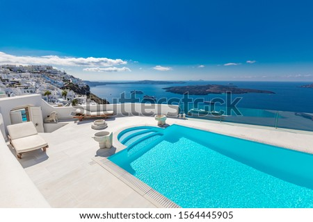 Perfect view in Santorini with white architecture luxury infinity pool over cruise ships and blue sea. Luxury summer vacation and holiday concept. Amazing landscape caldera view #1564445905