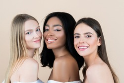 Perfect woman smiling. Womens day. International group of young smiling girls together, youth. Beauty natural woman on beige background. Multi-ethnic beauty