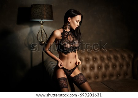 Stock Photo Perfect young girl in sexy black lingerie in glamour style