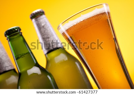 Perfectly chilled beer on yellow background shot in studio!