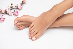 Perfectly done french pedicure on white background.