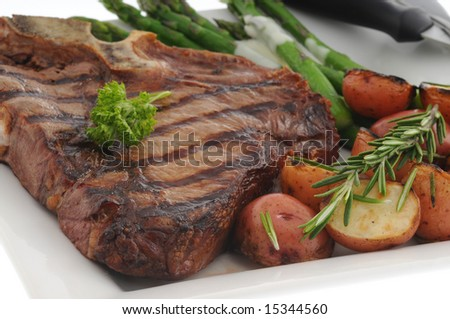Perfectly grilled t-bone steak with roasted vegetables.