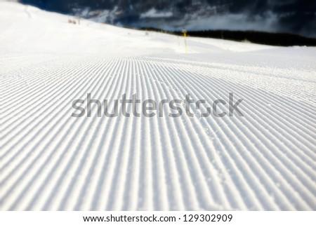 perfectly groomed empty  ski run