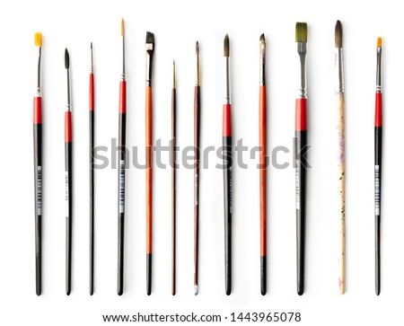 Perfectly lined set of brushes for painting purpose, isolated on white background