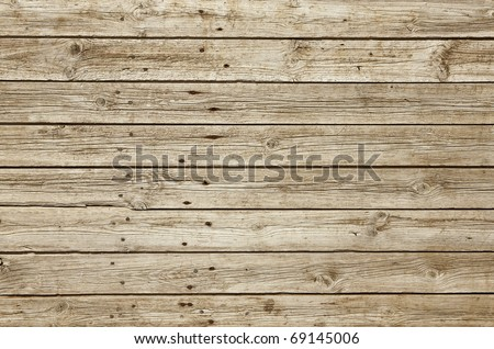 Perfectly lit wooden background with weathered wood and ruusty nails