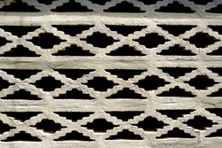 Perforated brick wall. perforated framework background, texture on white brick wall
