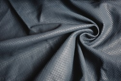 perforated genuine leather background texture.