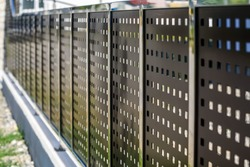 Perforated Metal Fence. Metal sheet panel fence