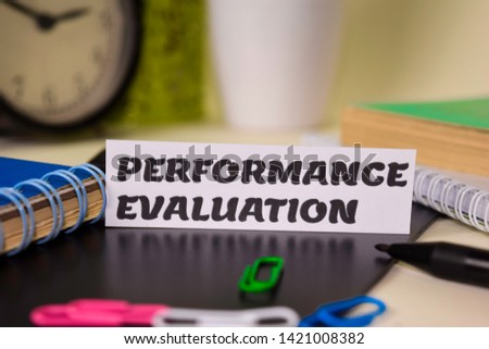 Performance Evaluation on the paper isolated on it desk. Business and inspiration concept #1421008382