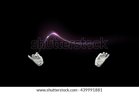performance, illusion, circus, show concept - magician hands in gloves with illuminating magic wand showing trick over black background #439991881