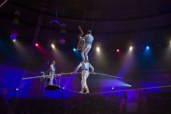 performance of aerialists in the circus arena