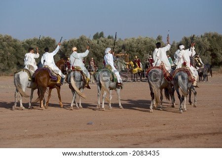 Performance of the traditional Fantasia in Morocco. The riders reach a galop at 60 km per hour and fire their musketeers.
