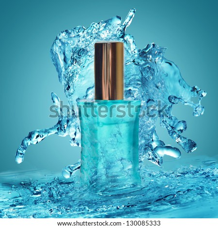Perfume bottle and water splash around it