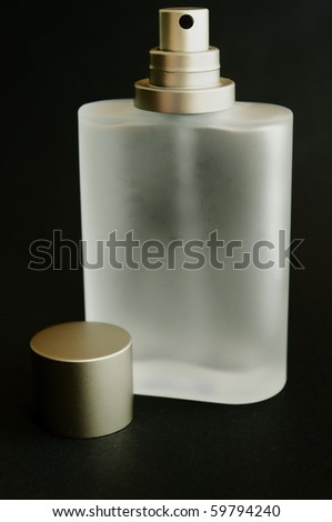 Perfume bottle in black background