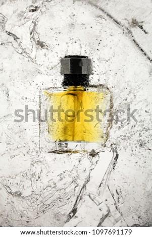 perfume bottle in broken ice